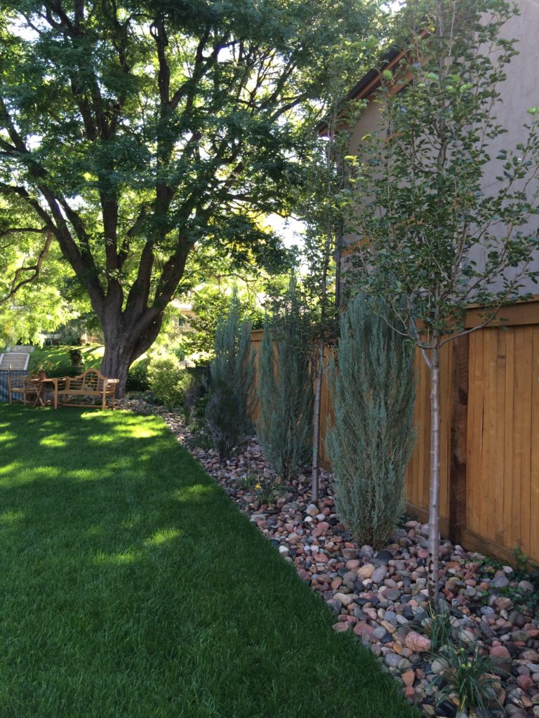 Wood Privacy Fence and Rock Border