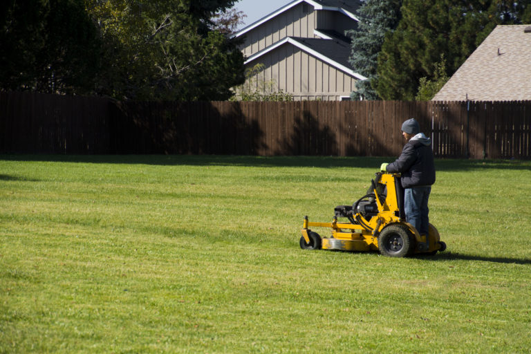 Horizon Employee on Standing Riding Lawn Mower