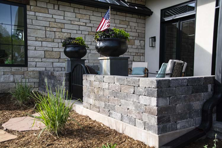 Stone wall around front patio