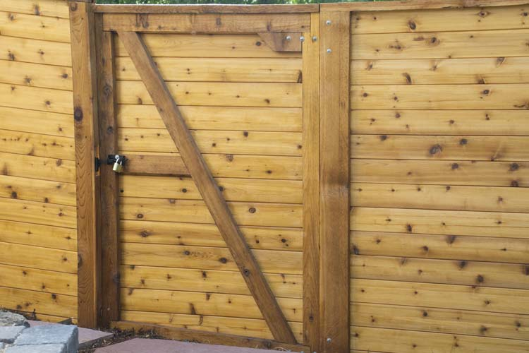 Horizontal wooden fence gate