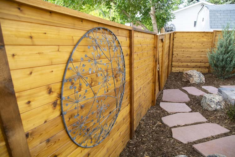 Sandstone path and horizontal wooden fence