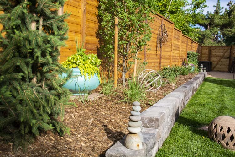 Brick retaining wall and horizontal wood fence
